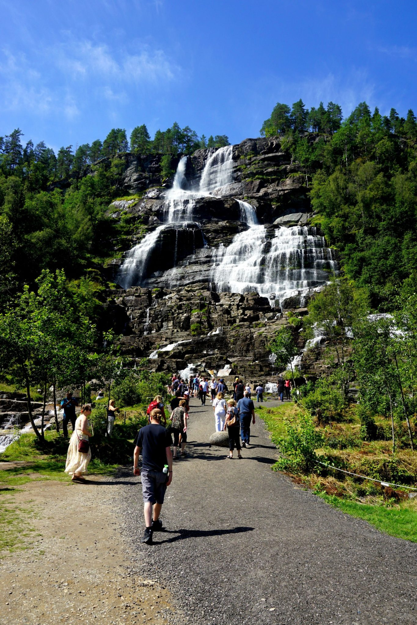 Tourists making their way to the Tvindefossen, some of them eager to fill containers as the water is said to be magical.